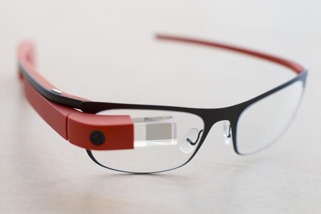 """The new Google Glass """"Thin"""" prescription frames in """"tangerine"""" color rests on a table at the Google Glass Basecamp space at Chelsea Market, Friday, Jan. 24, 2014, in New York. (AP Photo/John Minchillo)"""